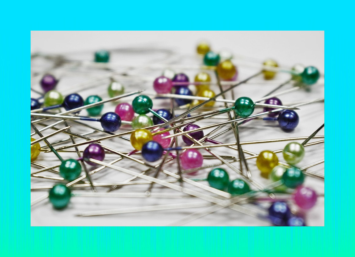 https://pixabay.com/photos/pins-colored-pins-scattered-sewing-1358849/
