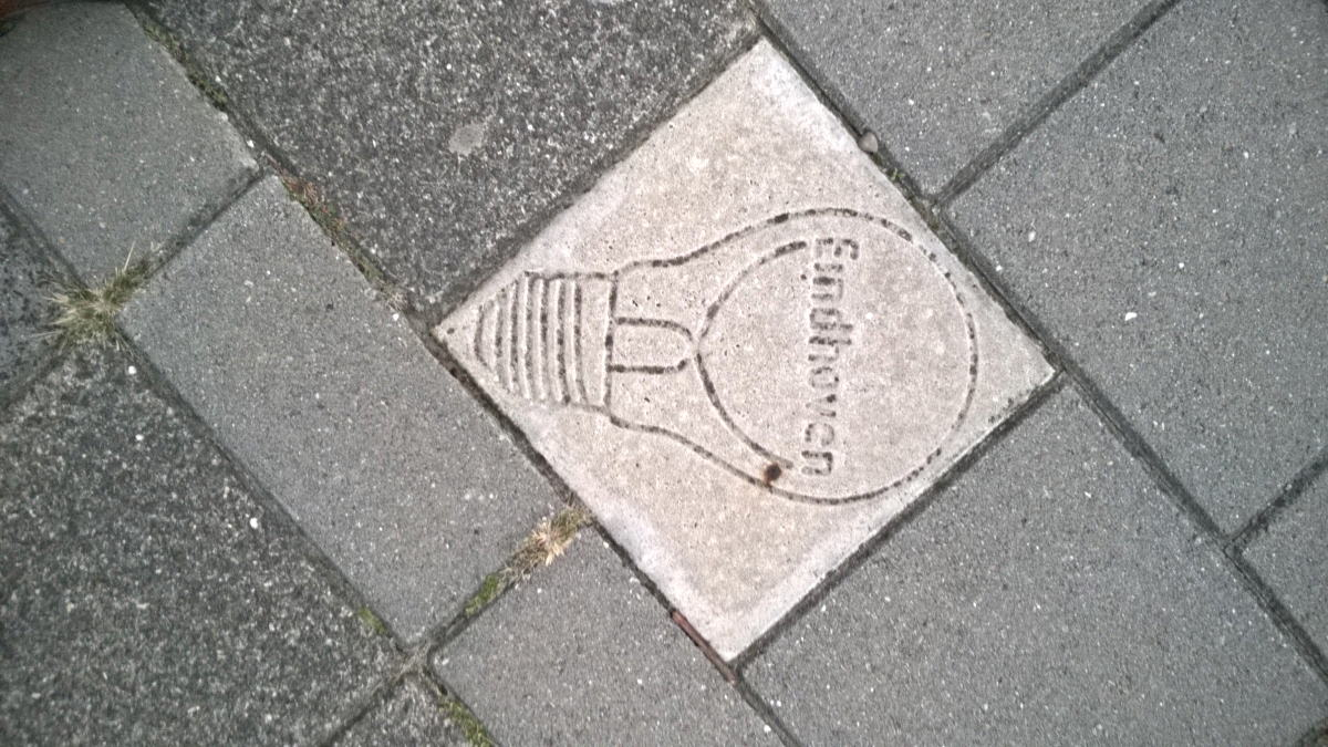 a tile on the footpath